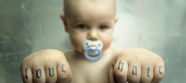 baby with love:hate fists