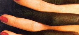 Two hands intertwined, a white female with red fingernails and a black male hand.