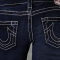 A close-up of a rear-end with brand name True Relgion Jeans on.