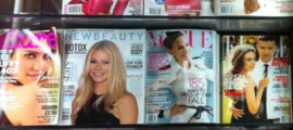 A newstand with all the latest glossy glamourous magazine covers
